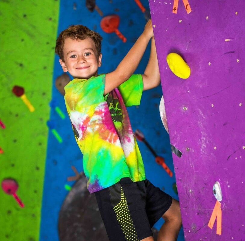 Lucas climbing at the indoor summer camp at the ABC gym in Boulder, CO.
