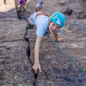 Kids practicing crack-climbing at an ABC summer camp in Boulder, CO.