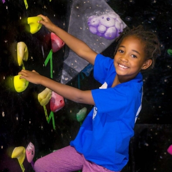 Eliana indoor climbing at summer camp in Boulder