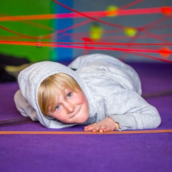 "Kid under the ""Spider Web"" at the ABC gym during summer camps."